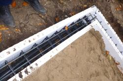 Insulated concrete forms work great for pond collars - much faster than building forms