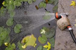 Never submerse your refill hose in the pond. Use a timer refill for auto shutoff