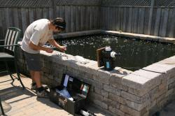 Water quality testing at a clients pond